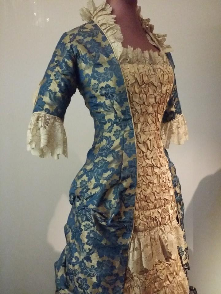 "Dress, 1878. ""Natural form"" - any bustle-like effect was established by draping the fabric. Source: Wikimedia Commons."