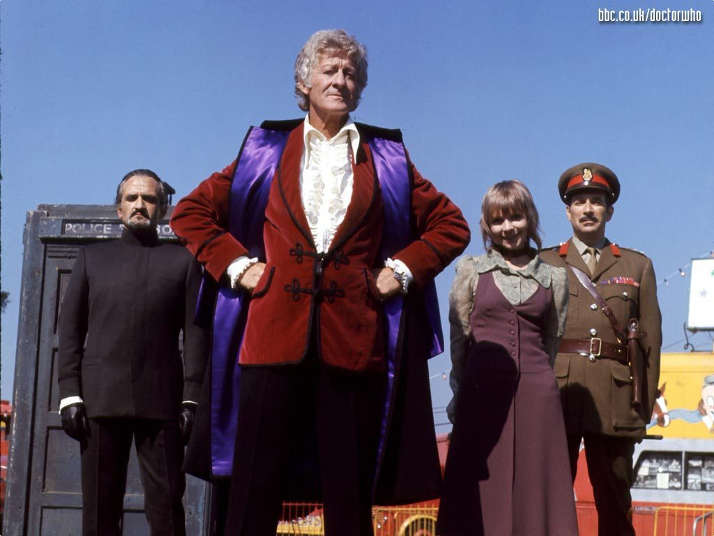 The 3rd Doctor and friends. Dig the velvet jacket. Source: BBC.