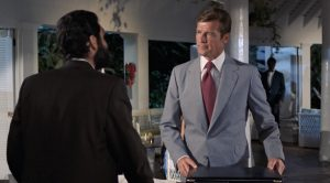 Bond in a worsted flannel suit. Don't look at the tie, just the suit... Source: thesuitsofjamesbond.com