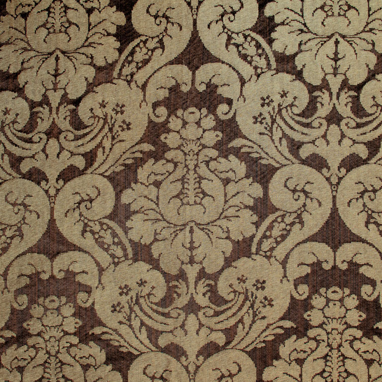 Damask. This is woven with a thread of a single color, which just goes to show how the choice of weave can impact a fabric's appearance.