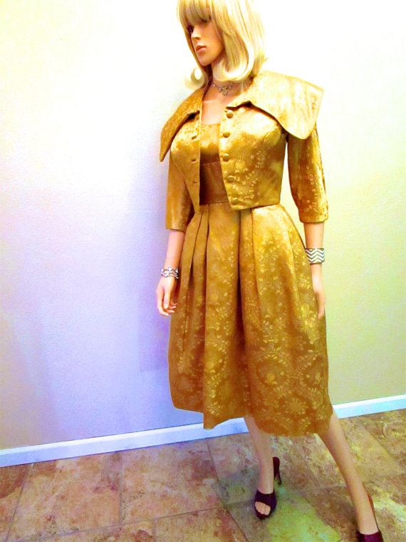 A vintage dress with lurex yarns in the fabric. Source: Etsy seller Moxie2RunwayVintage