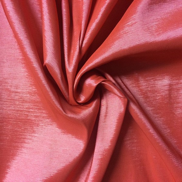 Stretch taffeta - a blend of polyester, nylon and elastane. Source: fabricwholesaledirect.com