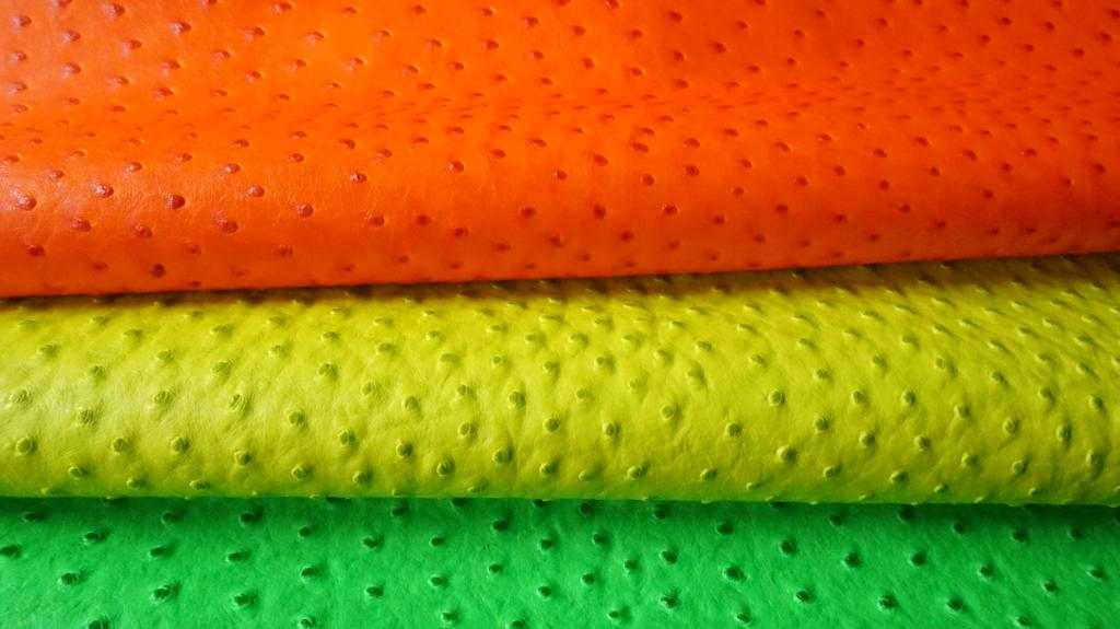 Vinyl embossed to resemble neon ostrich leather. I've never seen a neon ostrich. Source: eBay.