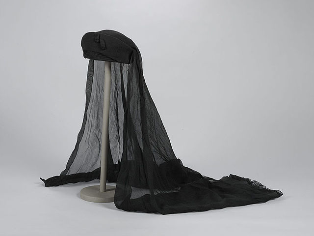 Hat with silk voile trim.